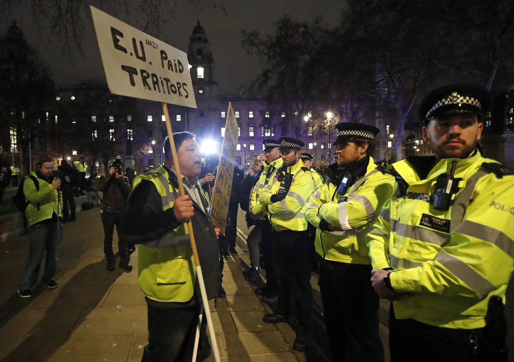 An pro-Brexit demonstrator confronts police officers in Parliament square in London, Tuesday, Jan. 15, 2019. Rival groups of pro-Brexit and pro-EU demonstrators are rallying outside Britain's Parl ...