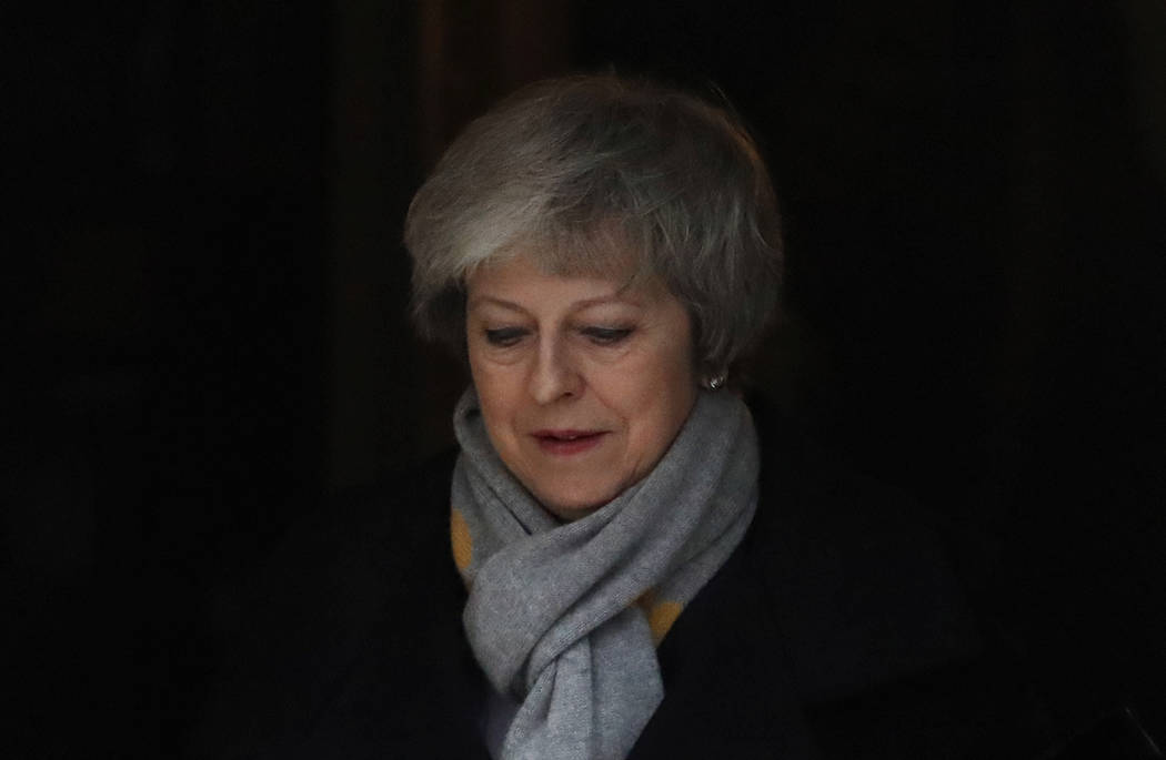 Britain's Prime Minister Theresa May leaves a cabinet meeting at Downing Street in London, Tuesday, Jan. 15, 2019. May is struggling to win support for her Brexit deal in Parliament. Lawmakers are ...