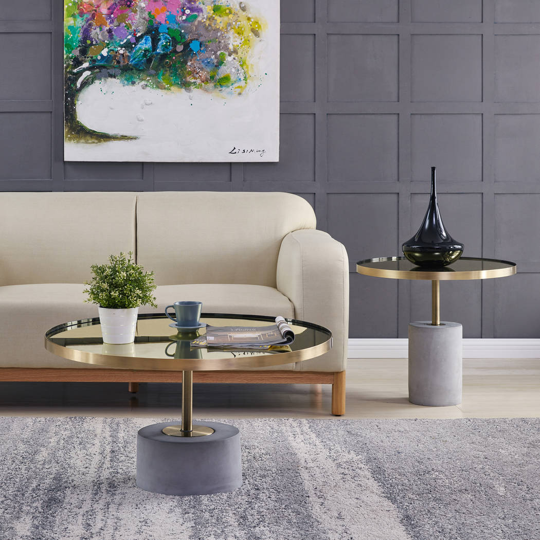 Andrea accent tables from New Pacific Direct are equal parts modern furniture and minimalist sculpture. A concrete base and steel bar support a mirrored glass tabletop that's wrapped in a metal ...