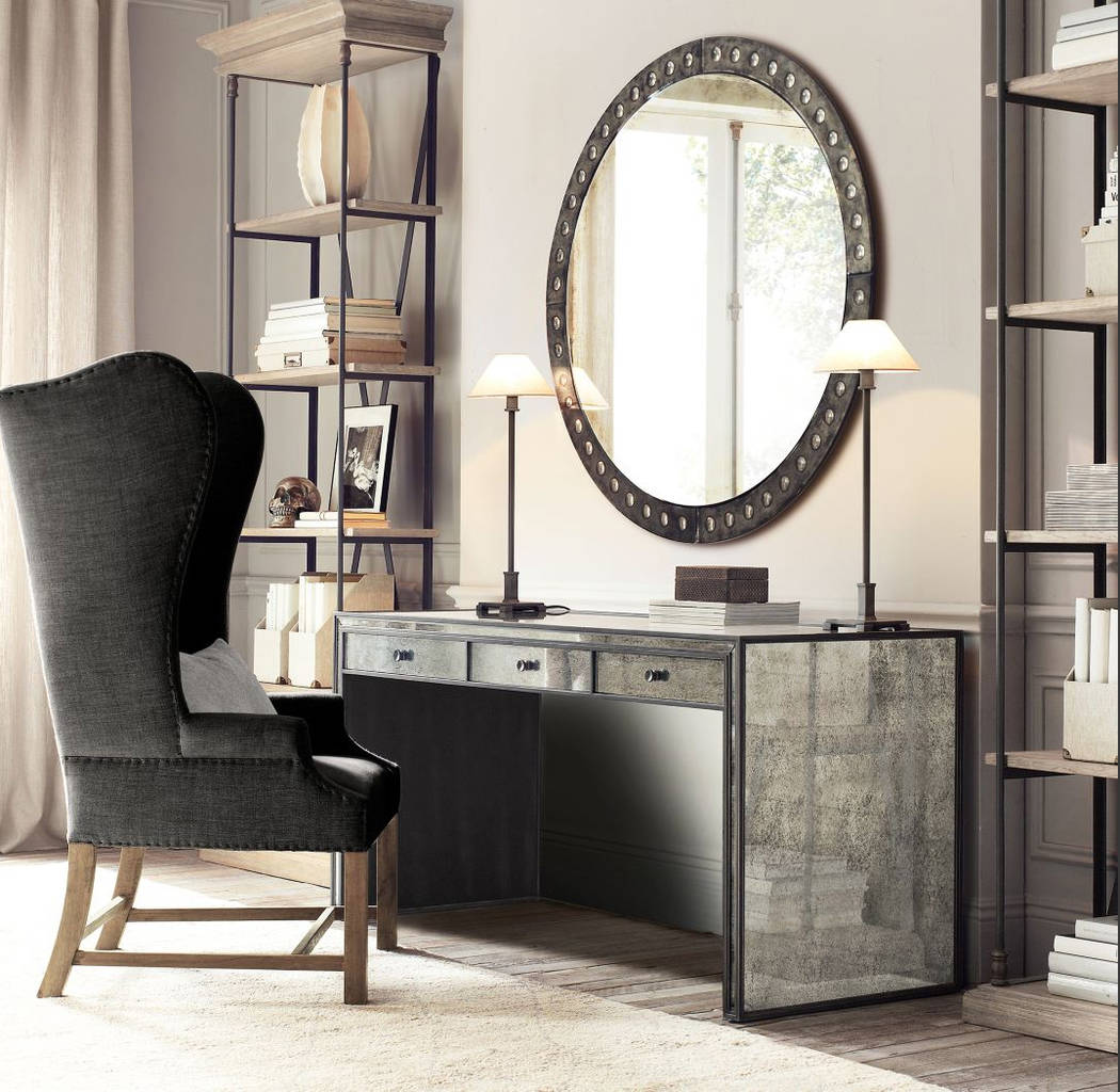 Recalling the streamlined simplicity of French art deco furnishings, RH's Strand mirrored desk strikes a harmonious balance between understated glamour and functional design. (RH)
