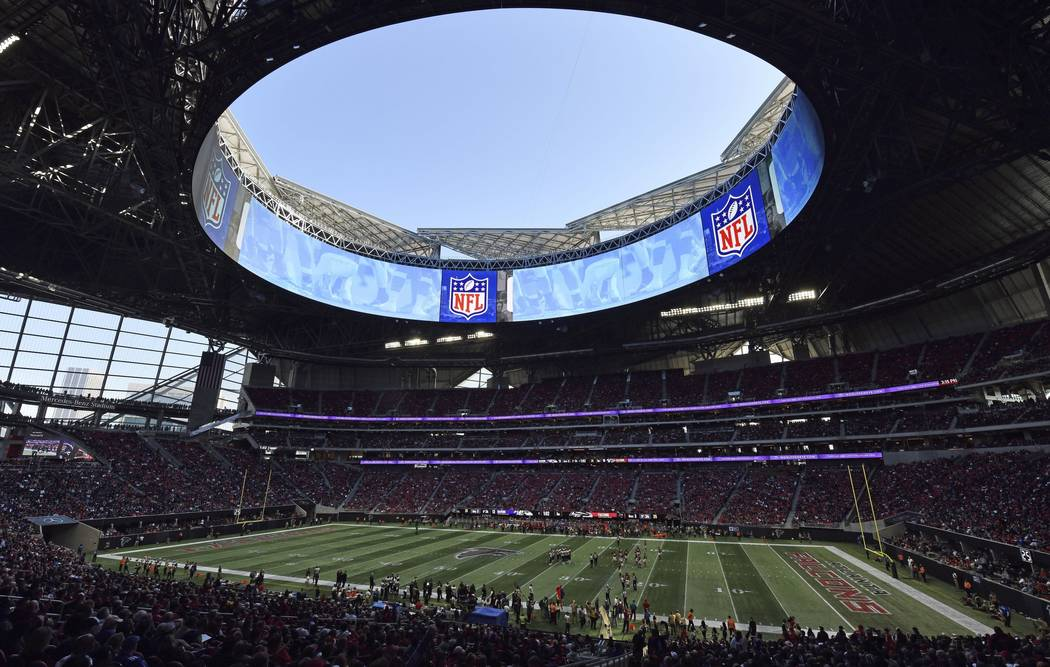 In this Sunday, Dec. 2, 2018, photo, the Atlanta Falcons play the Baltimore Ravens in the Mercedes-Benz stadium during the second half of an NFL football game, in Atlanta. Atlanta leaders, police ...