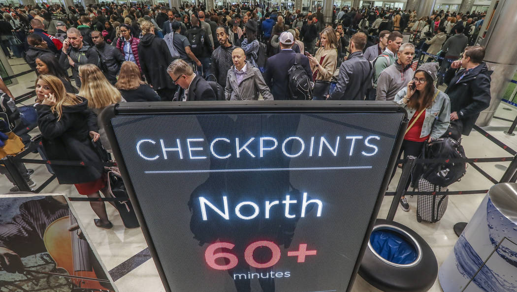 Security lines at Hartsfield-Jackson International Airport in Atlanta stretch more than an hour long amid the partial federal shutdown, causing some travelers to miss flights, Monday morning, Jan. ...