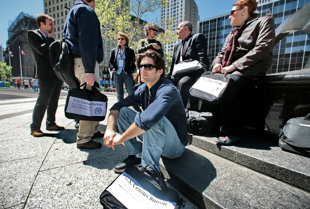 Census employees, including Joseph Mintz, seated, and Lesley Rubinger, far right, assemble after a training course in New York on April 29, 2010. A federal judge blocked the Trump administration T ...