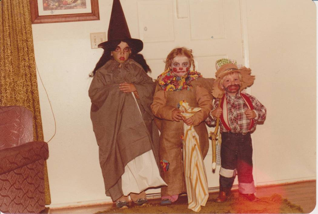 Michael Russell, right, poses with his older sisters Lisa, left, and Julie, center, in their Halloween costumes in an undated photo. (Russell family)