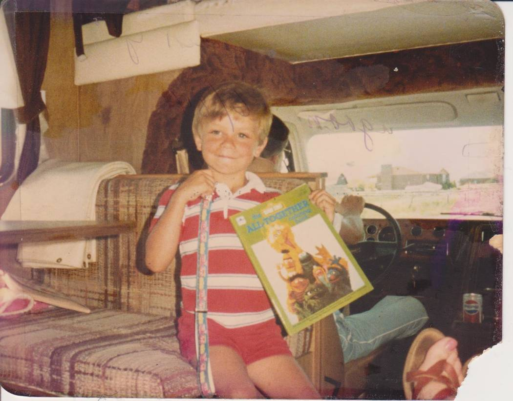 Michael Russell poses for a photo with his coloring book in an undated photo. (Russell family)
