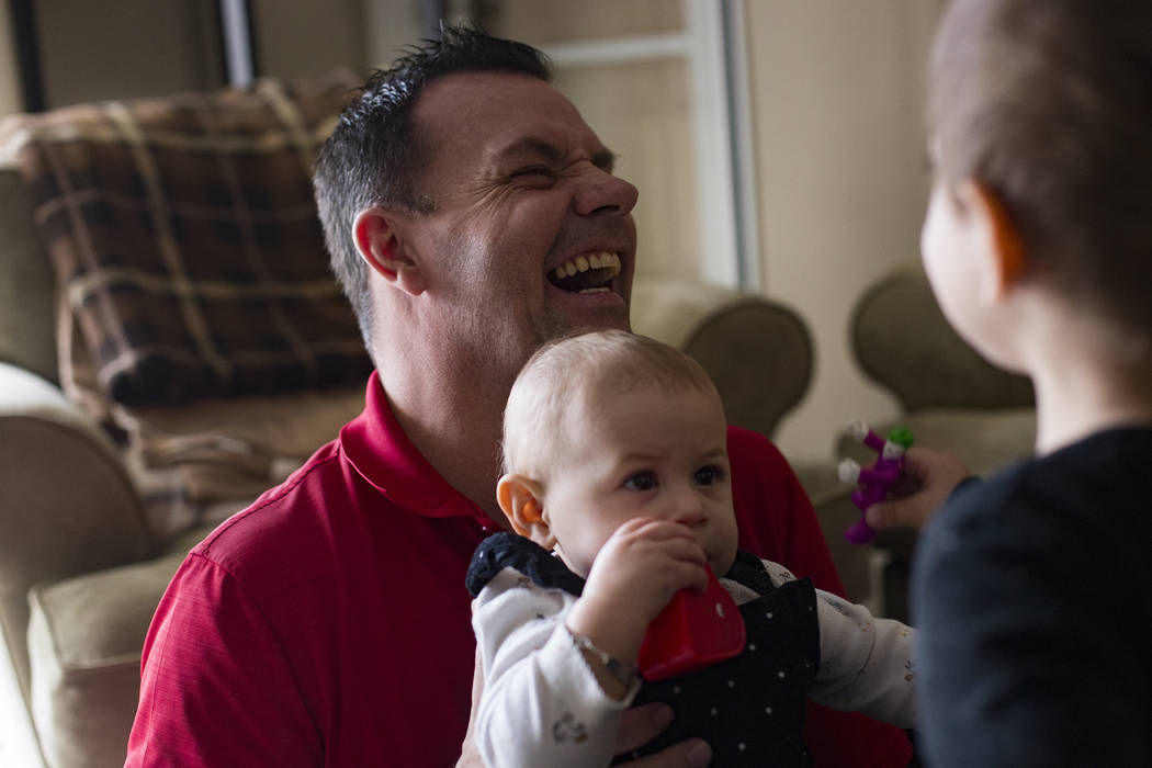 Michael Russell plays with his great nice Ava Gonzales, 11 months, at his home in Las Vegas, Friday, Jan. 11, 2019. When Michael was young, his father died, pushing his already rebellious streak i ...