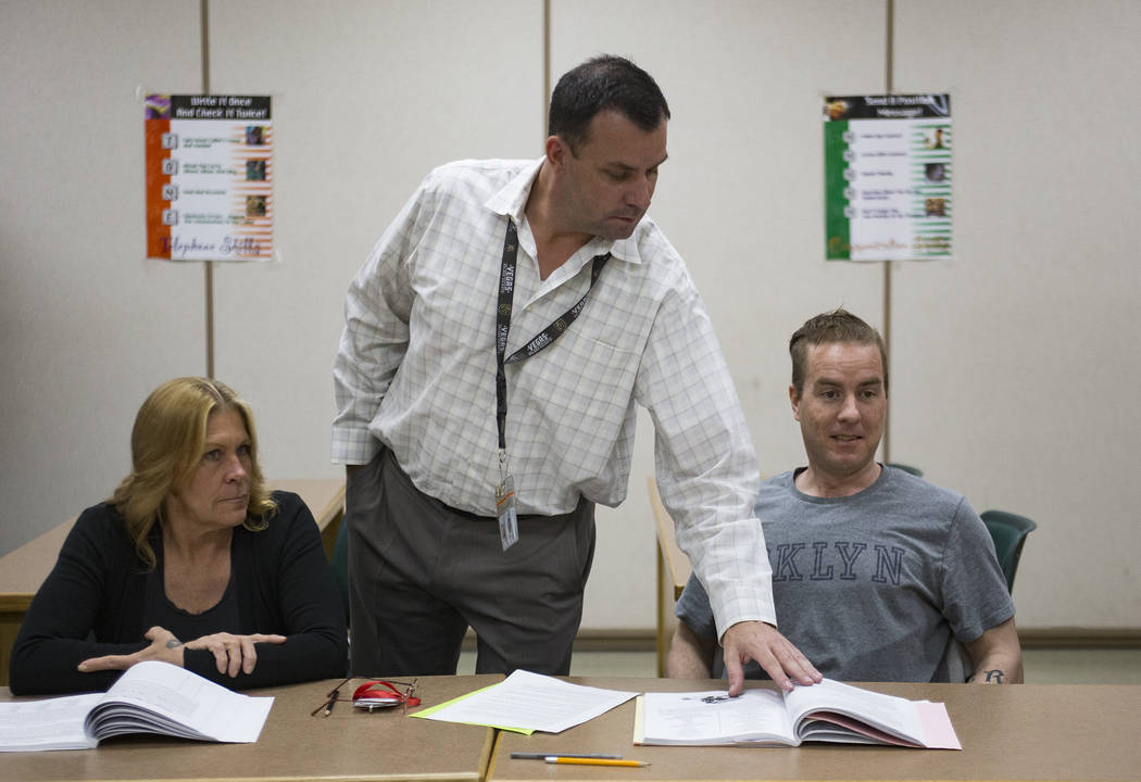 Michael Russell stands by inmates Carrie Kincaid and Andrew Morris as he leads a Moral Recognition Therapy class at Casa Grande, a transitional housing facility run by the Nevada Department of Cor ...