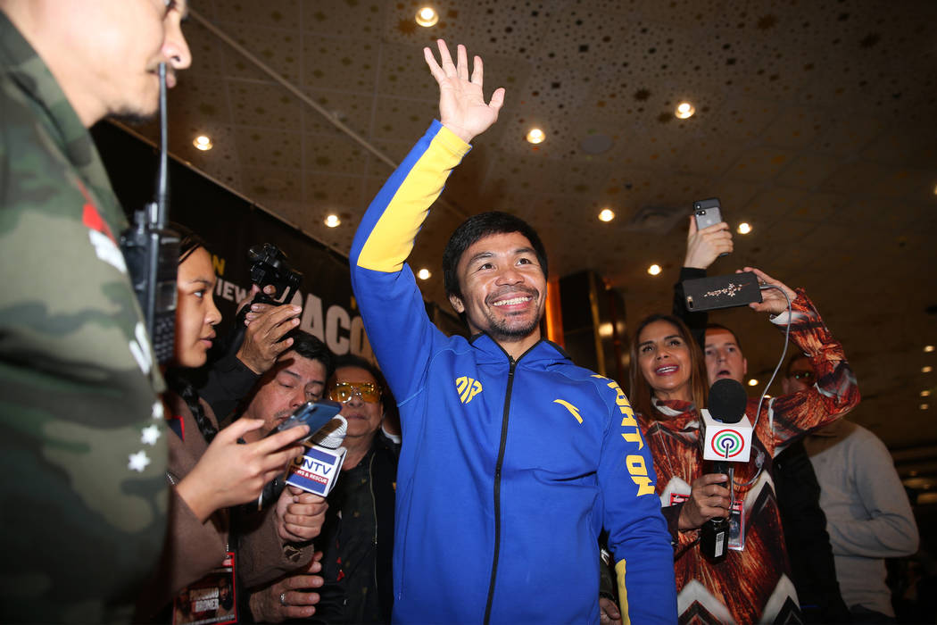Manny Pacquiao waves at fans on stage during his grand arrival at the MGM Grand casino-hotel in Las Vegas, Tuesday, Jan. 15, 2019. Erik Verduzco Las Vegas Review-Journal @Erik_Verduzco
