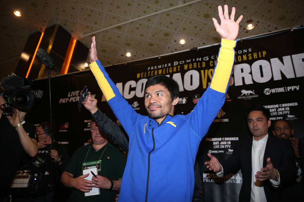 Manny Pacquiao raises his arms on stage during his grand arrival at the MGM Grand casino-hotel in Las Vegas, Tuesday, Jan. 15, 2019. Erik Verduzco Las Vegas Review-Journal @Erik_Verduzco