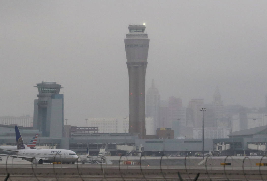 McCarran International Airport air traffic control tower and the Las Vegas Strip are shrouded in fog after rainfall on Tuesday, Jan. 15, 2019, in Las Vegas. Bizuayehu Tesfaye/Las Vegas Review-Jour ...