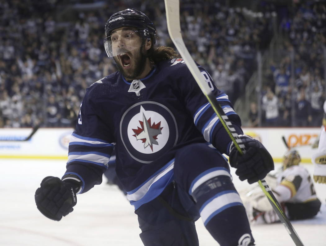 Winnipeg Jets' Mathieu Perreault celebrates after scoring on Vegas Golden Knights goaltender Marc-Andre Fleury (29) during the second period of an NHL hockey game Tuesday, Ja. 15, 2019, in Winnipe ...