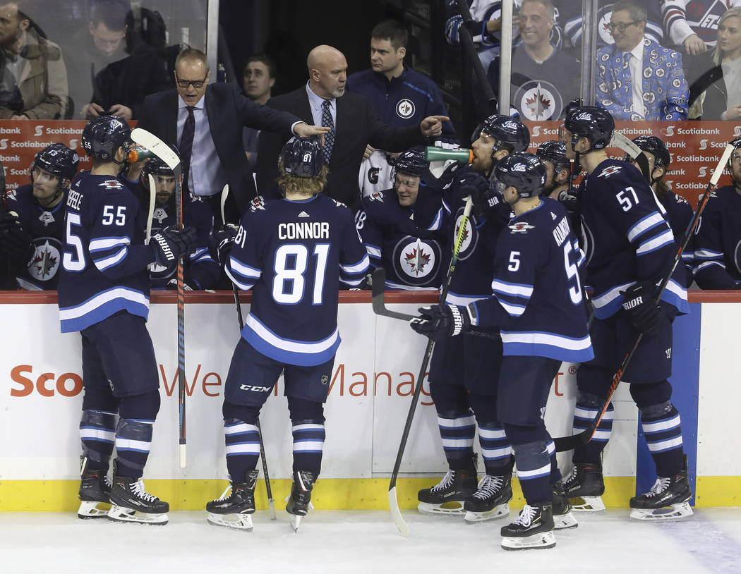 Winnipeg Jets coach Paul Maurice talks to players during a timeout during the third period of the team's NHL hockey game against the Vegas Golden Knights on Tuesday, Jan. 15, 2019, in Winnipeg, Ma ...