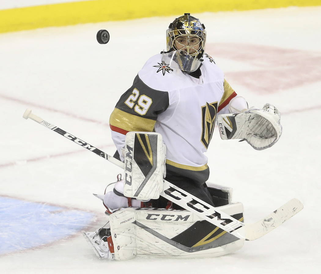 Vegas Golden Knights goaltender Marc-Andre Fleury watches a rebound during the first period of the team's NHL hockey game against the Winnipeg Jets on Tuesday, Ja. 15, 2019, in Winnipeg, Manitoba. ...