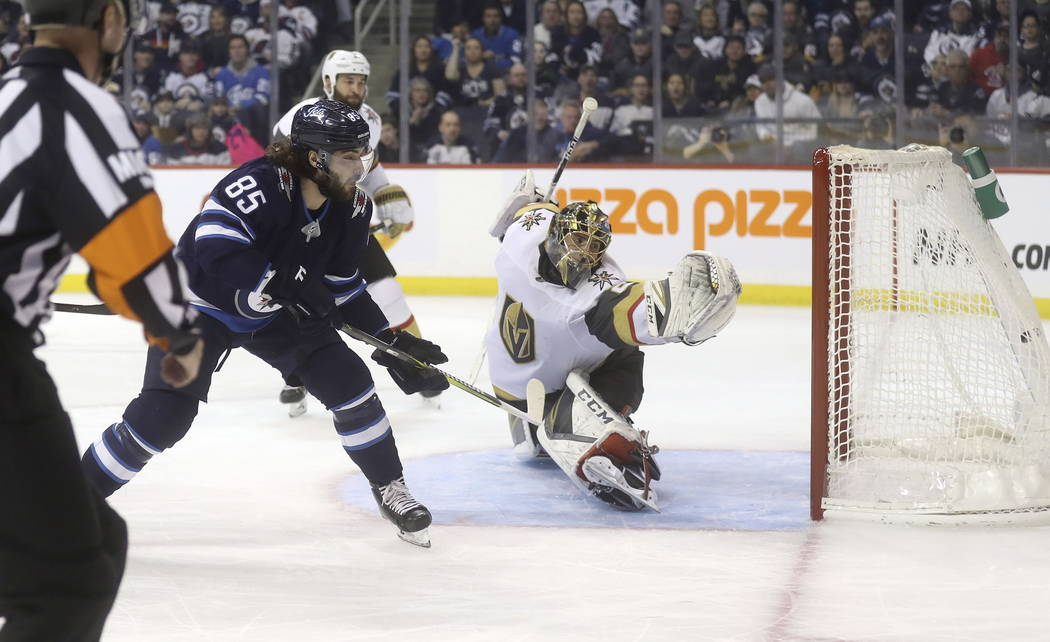 Winnipeg Jets' Mathieu Perreault (85) scores on Vegas Golden Knights goaltender Marc-Andre Fleury (29) during the second period of an NHL hockey game Tuesday, Ja. 15, 2019, in Winnipeg, Manitoba. ...