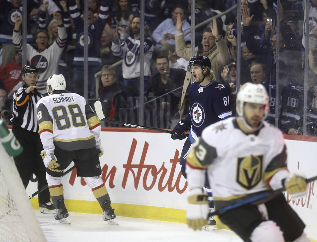Winnipeg Jets' Kyle Connor (81) celebrates after scoring against the Vegas Golden Knights' as Nate Schmidt (88) and Brandon Pirri (73) react during the second period of an NHL hockey game Tuesday, ...