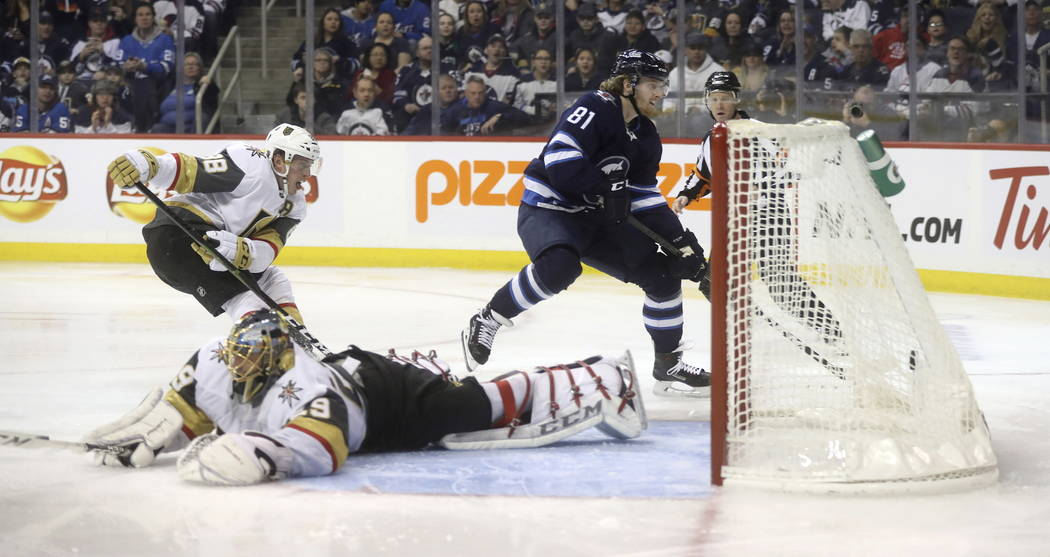 Winnipeg Jets' Kyle Connor (81) scores a short-handed goal on Vegas Golden Knights goaltender Marc-Andre Fleury (29) as Nate Schmidt (88) defends during the second period of an NHL hockey game Tue ...