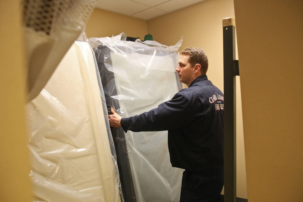 Engineer Travis Jackson stacks a mattress in a dorm at Fire Station 22 in Las Vegas, Wednesday, Jan. 16, 2019. Walker Furniture delivered new mattresses to all 30 Clark County firehouses in the La ...
