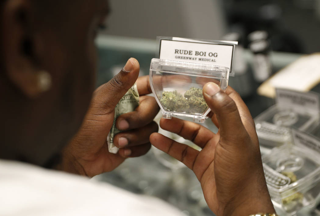 A customer shops for marijuana at the Exhale Nevada dispensary, Friday, April 20, 2018, in Las Vegas. April 20, or 4/20, is the numerical code for marijuana's high holiday, a homage to pot's endur ...