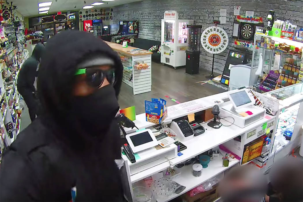 Police are looking for 4 people who robbed a smoke shop at 9355 W. Flamingo Road. (Smokes Mart/YouTube)