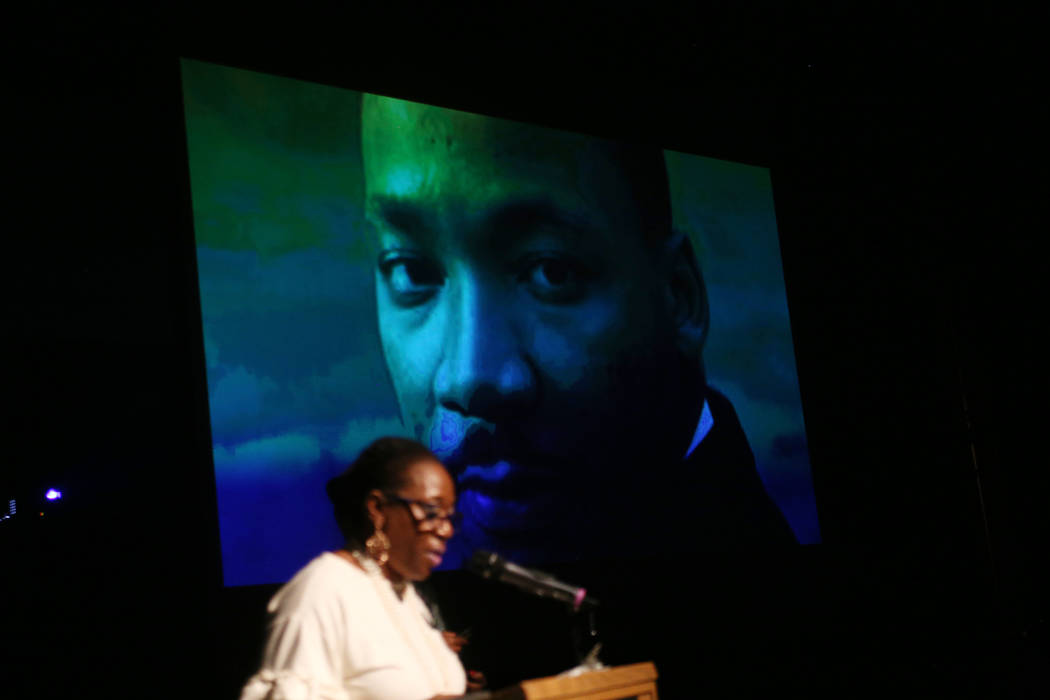 Cassandra Lewis addresses the crowd before announcing community awards below a picture of Martin Luther King Jr. at the Peace Week Celebration at West Las Vegas Library in Las Vegas, Sunday, Jan. ...
