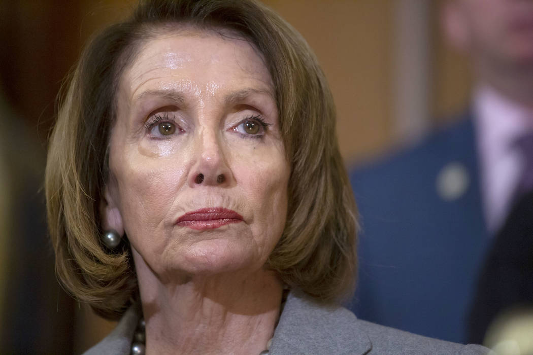 In this Wednesday, Jan. 9, 2019 file photo, Speaker of the House Nancy Pelosi, D-Calif., meets with furloughed federal workers at an event on Capitol Hill in Washington . (AP Photo/J. Scott Applew ...