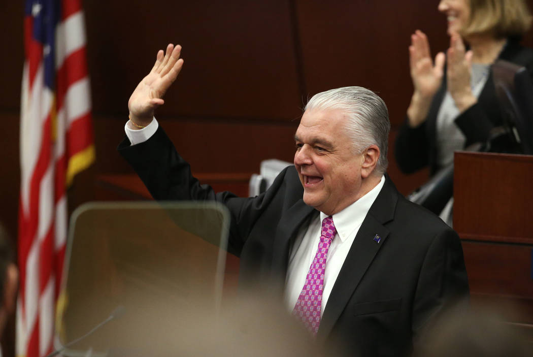 Nevada Gov. Steve Sisolak waves to lawmakers before delivering his State of the State address to the Legislature in Carson City, Nev., on Wednesday, Jan. 16, 2019. (Cathleen Allison/Las Vegas Revi ...