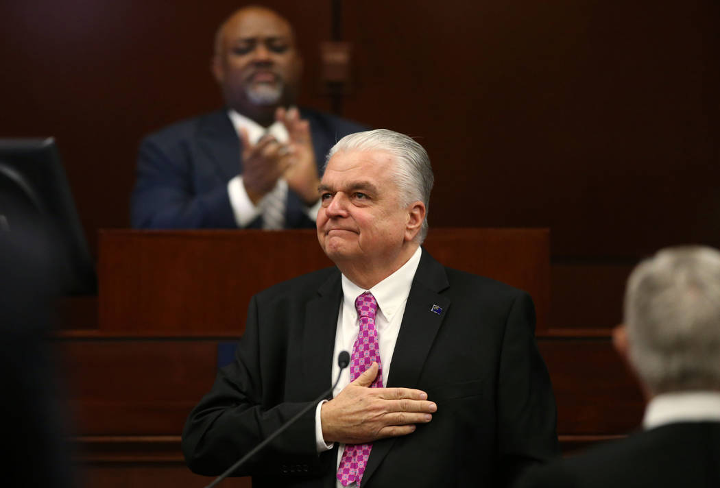 Nevada Gov. Steve Sisolak pats his heart in response to applause after delivering his State of the State address to the Legislature in Carson City, Nev., on Wednesday, Jan. 16, 2019. (Cathleen All ...