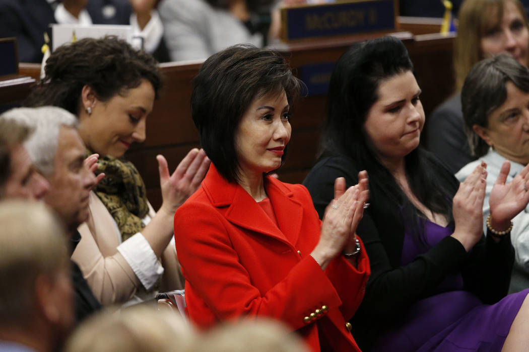 First Lady Kathy Sisolak, center, listens as Nevada Gov. Steve Sisolak delivers his State of the State address to the Legislature in Carson City, Nev., on Wednesday, Jan. 16, 2019. His daughter As ...