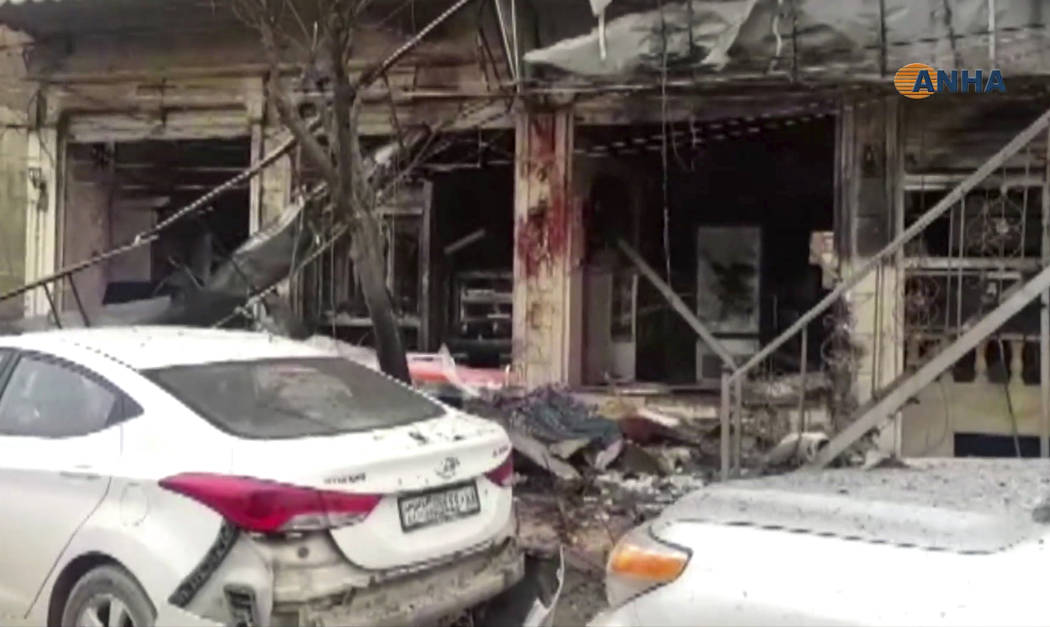This frame grab from video provided by Hawar News, ANHA, the news agency for the semi-autonomous Kurdish areas in Syria, shows a damaged restaurant where an explosion occurred, in Manbij, Syria, W ...