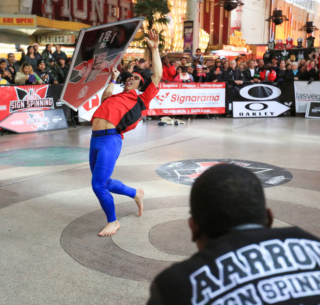Jose Angeles, from Northern California, competes in the 10th annual World Sign Spinning Championships on the Fremont Street Experience in Las Vegas on Saturday, Feb. 25, 2017. Angeles took first p ...