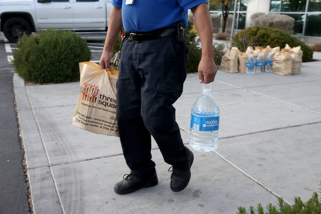 A Transportation Security Administration employee loads donated items to a car at TSA administrative offices in Las Vegas Wednesday, Jan. 16, 2019. Local food bank Three-Square supplied over 400 b ...