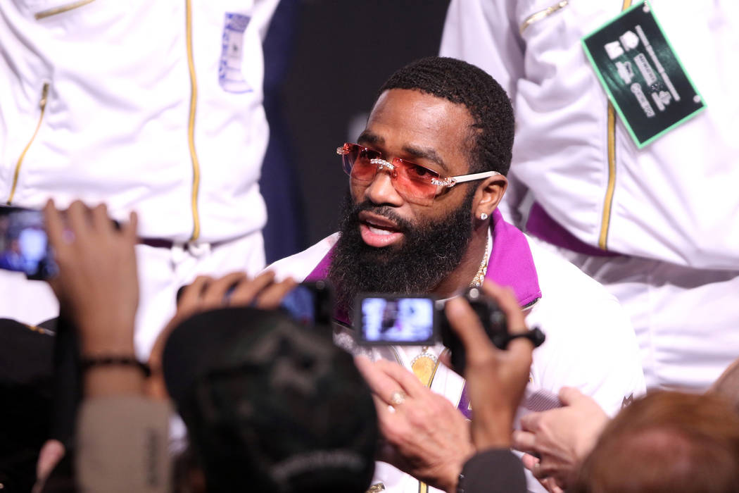 Former four-division world champion boxer Adrien Broner meets with media following a news conference to promote his fight on Jan. 19 against Manny Pacquiao, not pictured,at the David Copperf ...