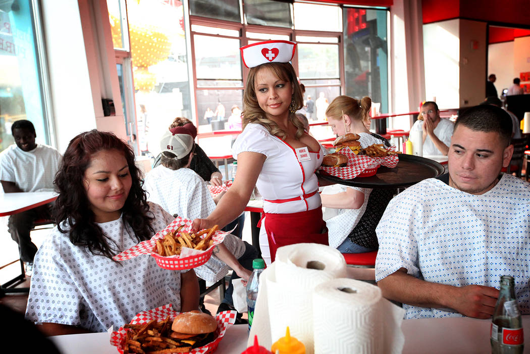 Jaimee Lee serves customers at the Heart Attack Grill in downtown Las Vegas on Monday, Mar. 5, 2012. (Jessica Ebelhar/Las Vegas Review-Journal)-