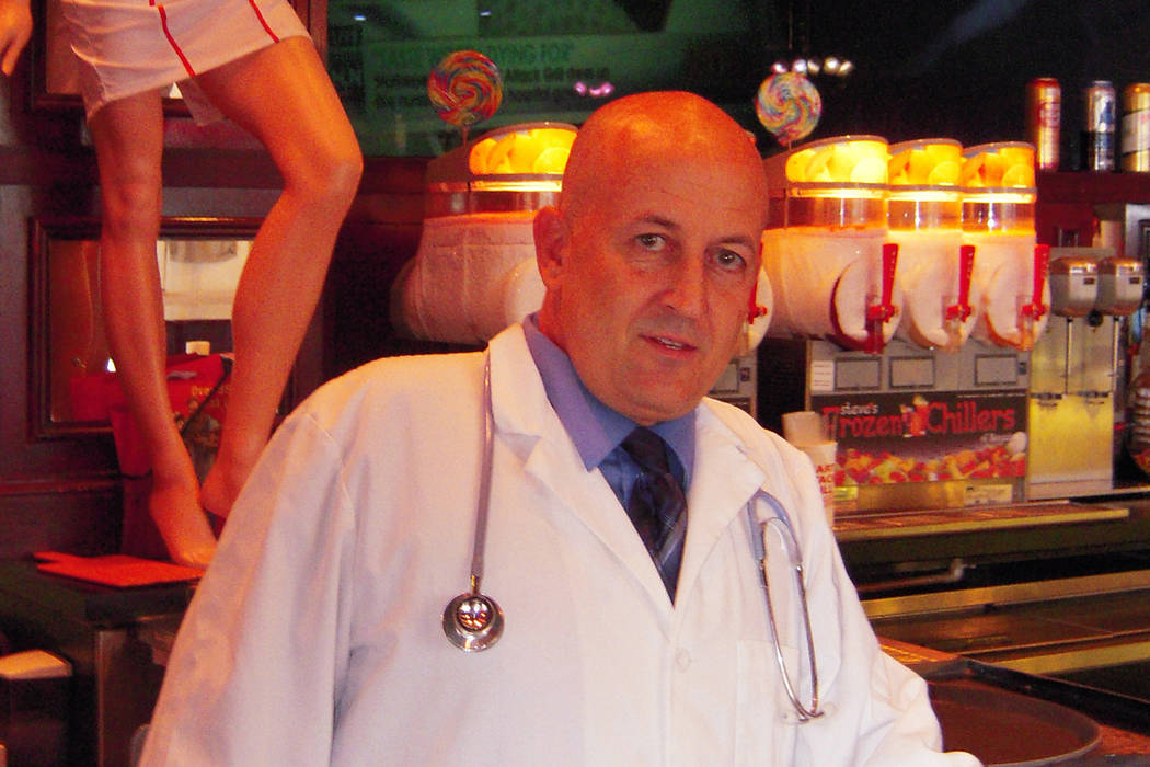 In this Wednesday, July 11, 2012 photo, Jon Basso, owner and bartender of the Heart Attack Grill, stands in his restaurant in Las Vegas. (AP Photo/David Crary)