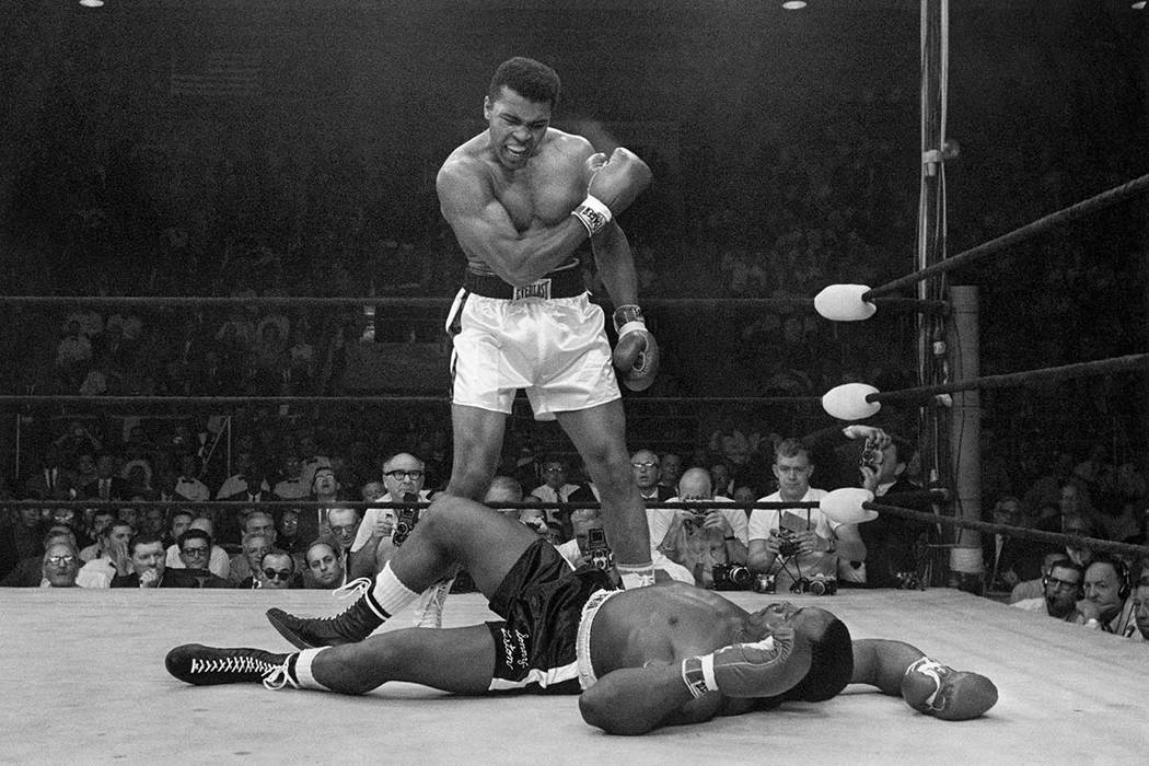 In this May 25, 1965 file photo, heavyweight champion Muhammad Ali stands over fallen challenger Sonny Liston, shouting and gesturing shortly after dropping Liston with a short hard right to the j ...