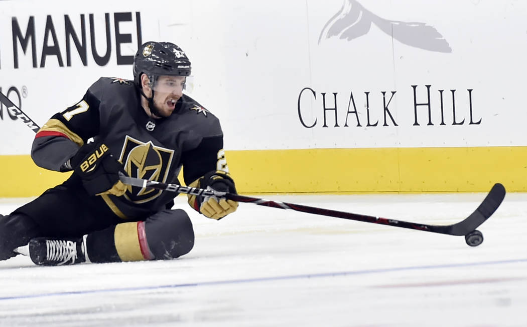 Vegas Golden Knights defenseman Shea Theodore (27) controls the puck during the second period of an NHL hockey game against the Colorado Avalanche on Thursday, Dec. 27, 2018, in Las Vegas. (AP Pho ...