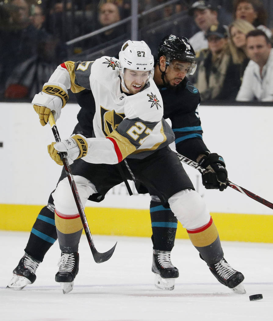 Vegas Golden Knights defenseman Shea Theodore (27) skates around San Jose Sharks left wing Evander Kane during the first period of an NHL hockey game Thursday, Jan. 10, 2019, in Las Vegas. (AP Pho ...