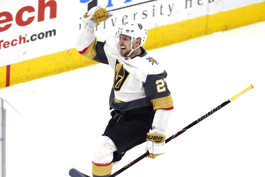Vegas Golden Knights defenseman Shea Theodore (27) celebrates after his goal against the Chicago Blackhawks during the overtime period of an NHL hockey game Saturday, Jan. 12, 2019, in Chicago. (A ...