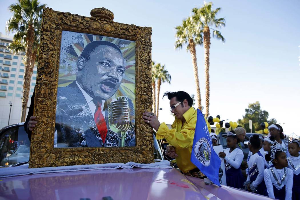 "Jesse Garon prepares for the 36th annual Dr. Martin Luther King Jr. Parade, themed ""Living the Dream: Building a Bridge to Unity,"" in downtown Las Vegas, Jan. 15, 2018. The parade featured floats, ..."