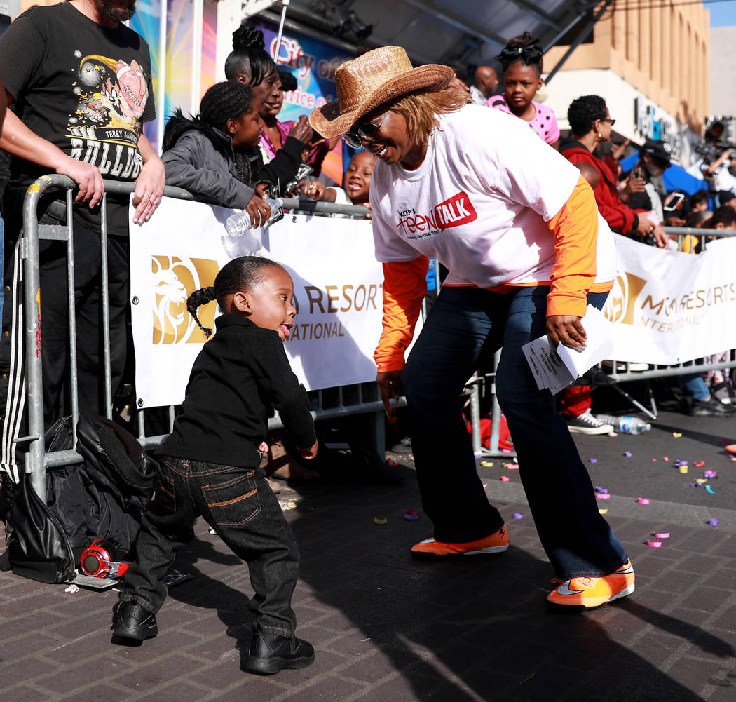 "Marquiste Kiles, 2, and Annette Walker Goggins dance during the 36th annual Dr. Martin Luther King Jr. Parade, themed ""Living the Dream: Building a Bridge to Unity"" in downtown Las Vegas, Jan. 15, ..."