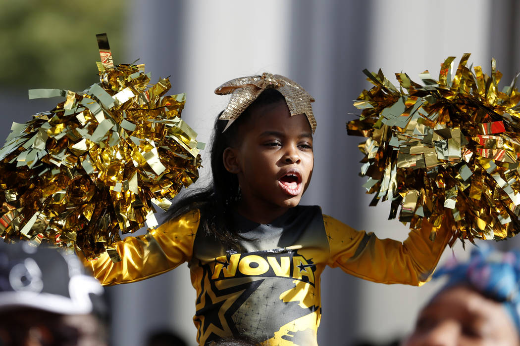 "Ny'Lei Patterson, 7, cheers for participants marching in the 36th annual Dr. Martin Luther King Jr. Parade, themed ""Living the Dream: Building a Bridge to Unity"" in downtown Las Vegas, Jan. 15, 20 ..."