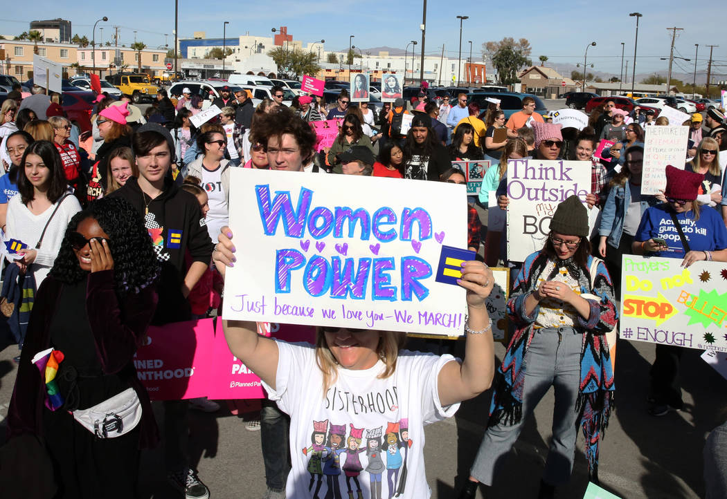 People gather to listen to speeches before participating in Empowering Women March on Saturday, Jan. 19, 2019, in downtown Las Vegas. Bizuayehu Tesfaye/Las Vegas Review-Journal @bizutesfaye