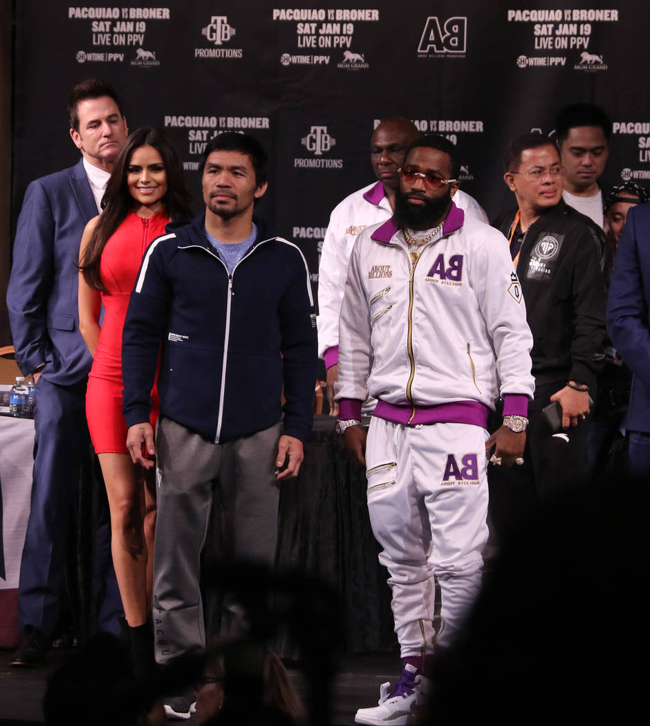 Boxers Manny Pacquiao, left, and Adrien Broner pose on Wednesday, Jan. 16, 2019 after a news conference at the David Copperfield Theater to promote their welterweight title bout taking place on Sa ...