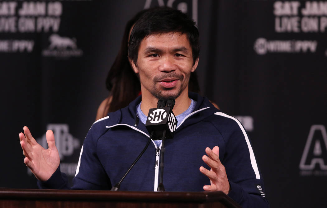 Manny Pacquiao, senator of the Philippines and eight-division world champion boxer, addresses the media during a news conference at the David Copperfield Theater at the MGM Grand in Las Vegas, Wed ...
