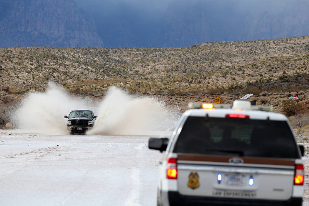 Cars drive through flood waters on Highway 159 in Red Rock Canyon National Conservation Area near Las Vegas Wednesday, Jan. 16, 2019. (K.M. Cannon/Las Vegas Review-Journal) @KMCannonPhoto