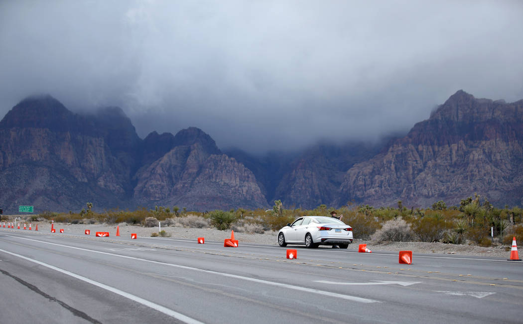 Traffic cones are blown over near the entrance to the closed Scenic Loop on Highway 159 in Red Rock Canyon National Conservation Area near Las Vegas Wednesday, Jan. 16, 2019. (K.M. Cannon/Las Vega ...