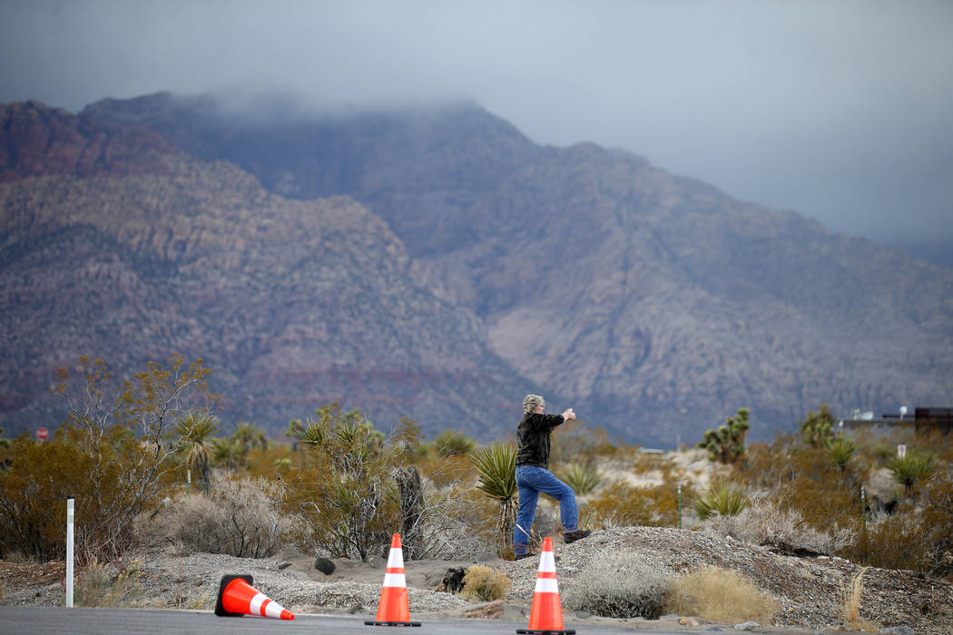 A person takes a photo near the entrance to the closed Scenic Loop on Highway 159 in Red Rock Canyon National Conservation Area near Las Vegas Wednesday, Jan. 16, 2019. (K.M. Cannon/Las Vegas Revi ...