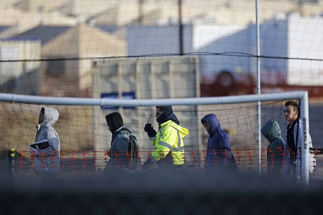 Teen migrants walk in line inside the Tornillo detention camp in Tornillo, Texas, Dec. 13, 2018. (Andres Leighton/AP, File)