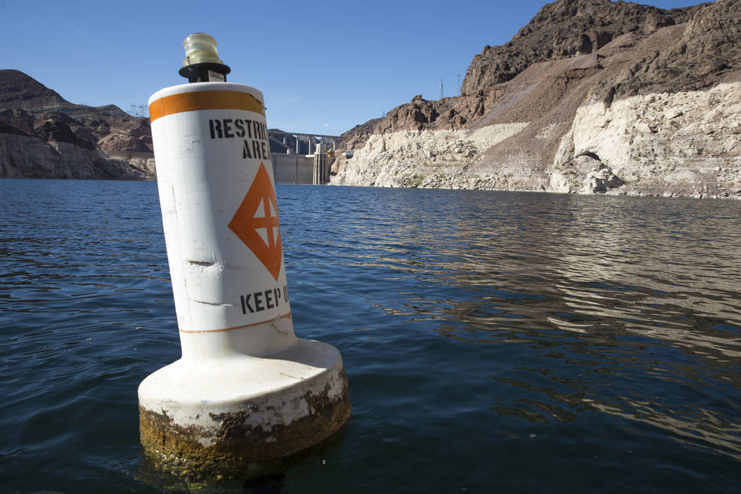 A buoy marks the restricted area to the Hoover Dam intake towers along the Colorado River's Black Canyon at Lake Mead National Recreation Area outside of Las Vegas on Wednesday, Oct. 17, 2018. (Ri ...