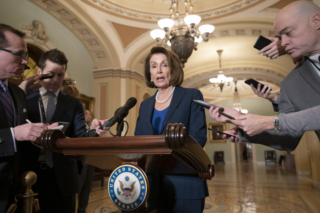 House Democratic Leader Nancy Pelosi of California, the speaker-designate for the new Congress in January, talks to reporters after meeting with Senate Minority Leader Chuck Schumer, D-N.Y., as Co ...